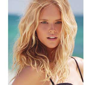 Model on the beach with blonde wavy hair