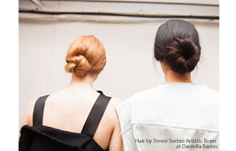 Model image of two models hair with messy buns