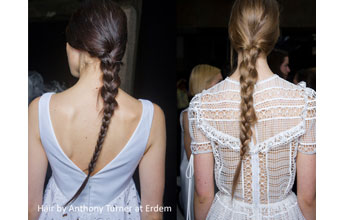 Two models with long hair in a plait