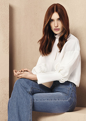 Model with foilyage sitting wearing jeans