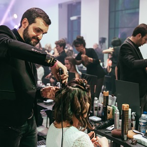 Hairdresser styling hair at a hairdressing event