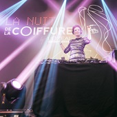 Image of a DJ with bring lights