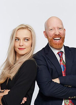 Blonde model smiling with man with ginger beard
