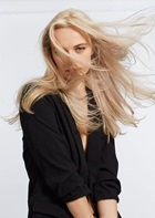 Blonde model with long wind swept hair