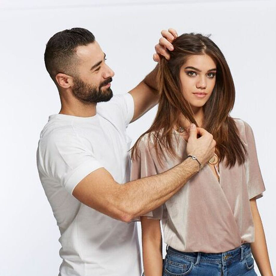 Hair Stylist Styling brunette woman's hair