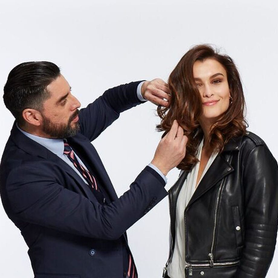 Brunette model with wavy hair being styled
