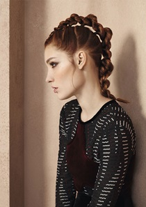 Red haired model with braided pony tail