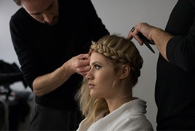 Blonde model with braid having hair done