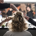 Blonde curly model having hair styled