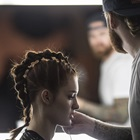 Model with braided hair being styled
