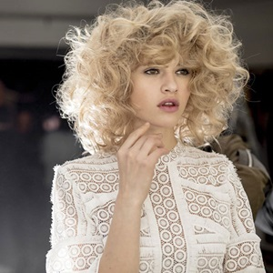 Curly blonde hair model on catwalk
