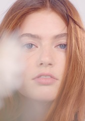 Red haired model in blurred focus