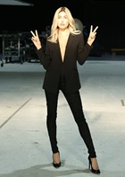 Hailey Baldwin posing doing peace signs