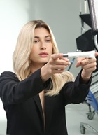 Hailey Baldwin holding pro fiber concentrate