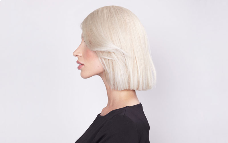 Side profile woman with shoulder length white blonde hair