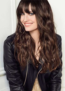 Eva Green with long brunette hair and black jacket
