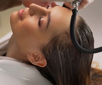 Woman having hair rinsed