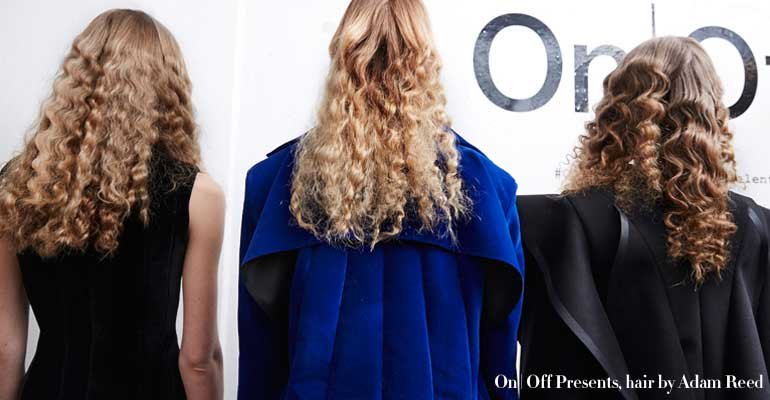 3 models with long curly hair at Fashion Week
