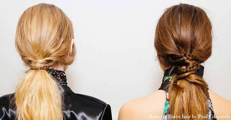 2 models with long tied back hair backs of heads