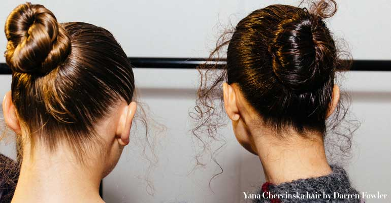 Two models with hair in buns