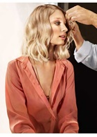 model in peach top with blush blonde hair colour