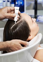 hair treatment being applied in salon