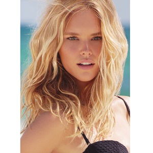 Blonde model on the beach with wavy hair